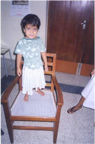 Orphan girl on chair