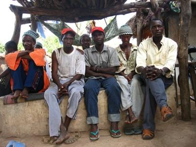 men sitting doing nothing